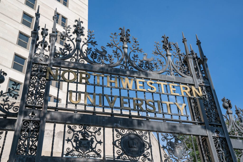 CHICAGO ILLINOIS USA - SEPTEMBER 18 2016: Elaborate iron gate entry on the Chicago campus of Northwestern University in Chicago Illinois.